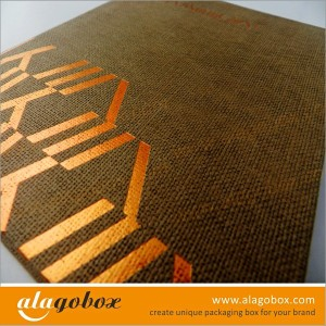 golden stamped logo onto textured paper box