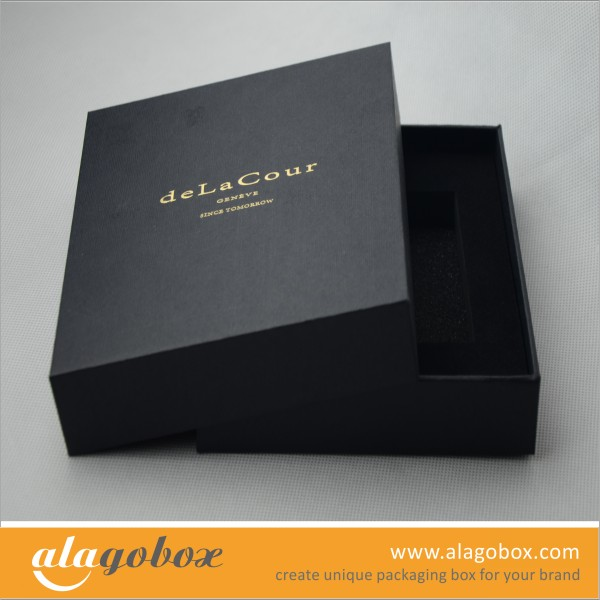 black and gold box with textured paper