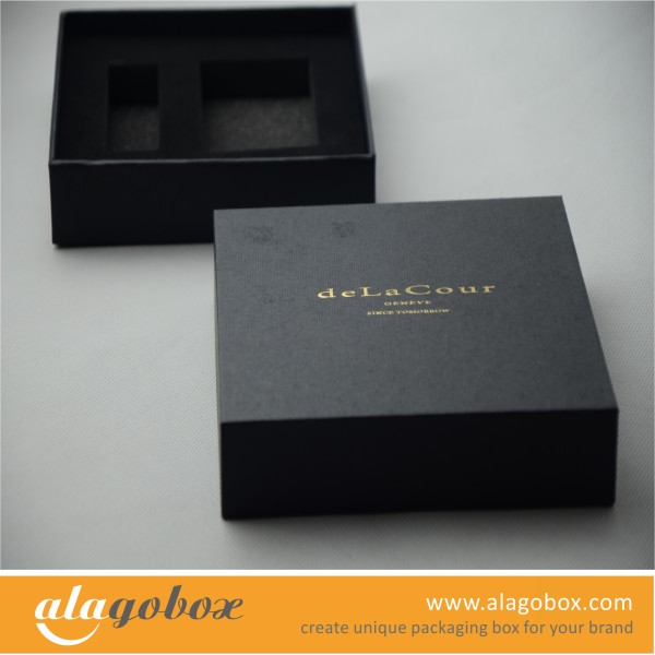 black textured gift box with golden logo