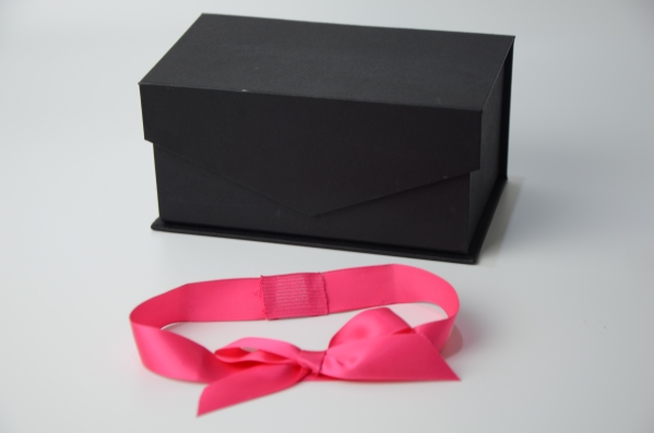 black box with pink bow