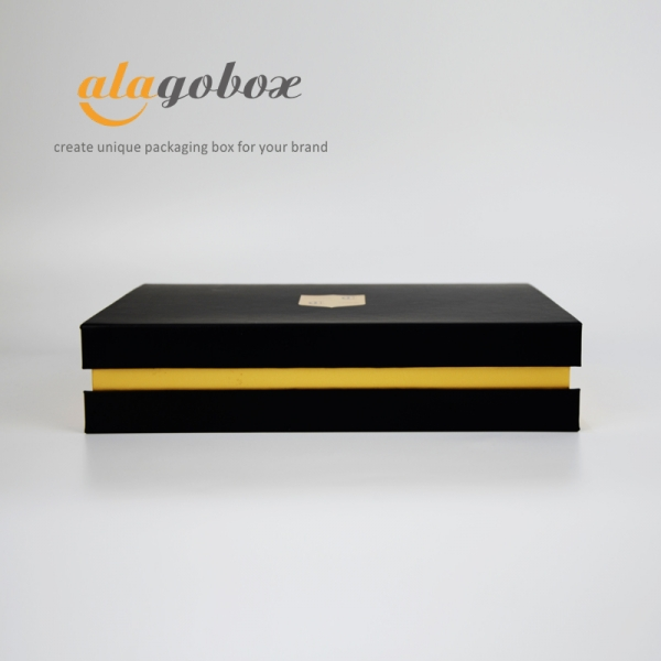 black and gold bookstyle box
