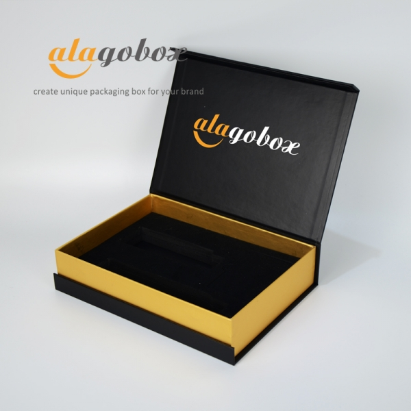 black and gold box with black foam